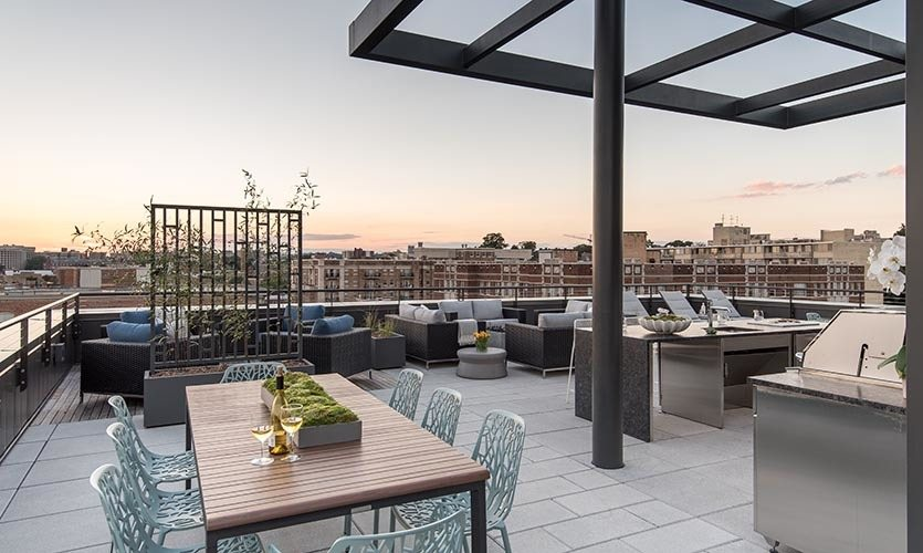 Rooftop lounge with dining and firepit