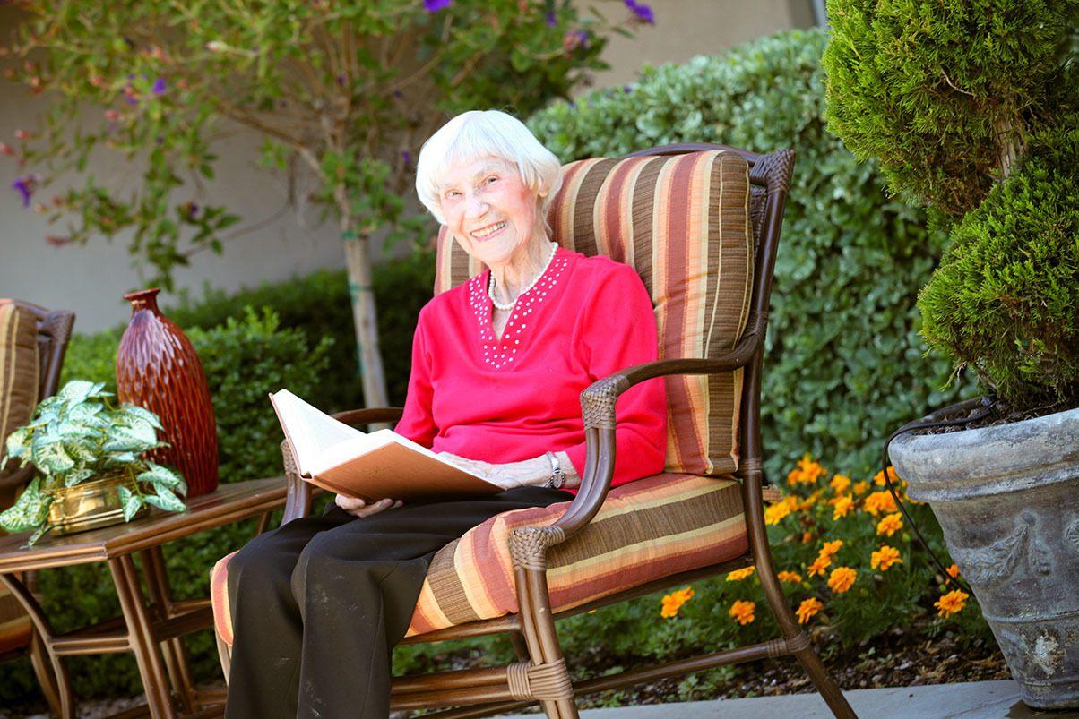 Read A Book Outdoors At Senior Living In Los Altos California