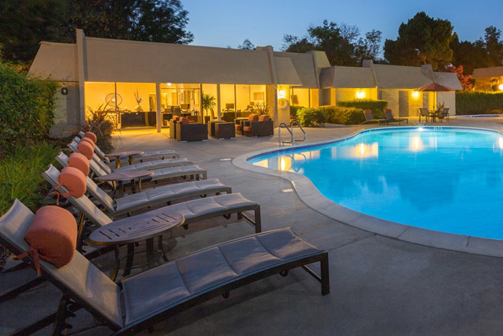 Fremont apartments includes poolside lounging