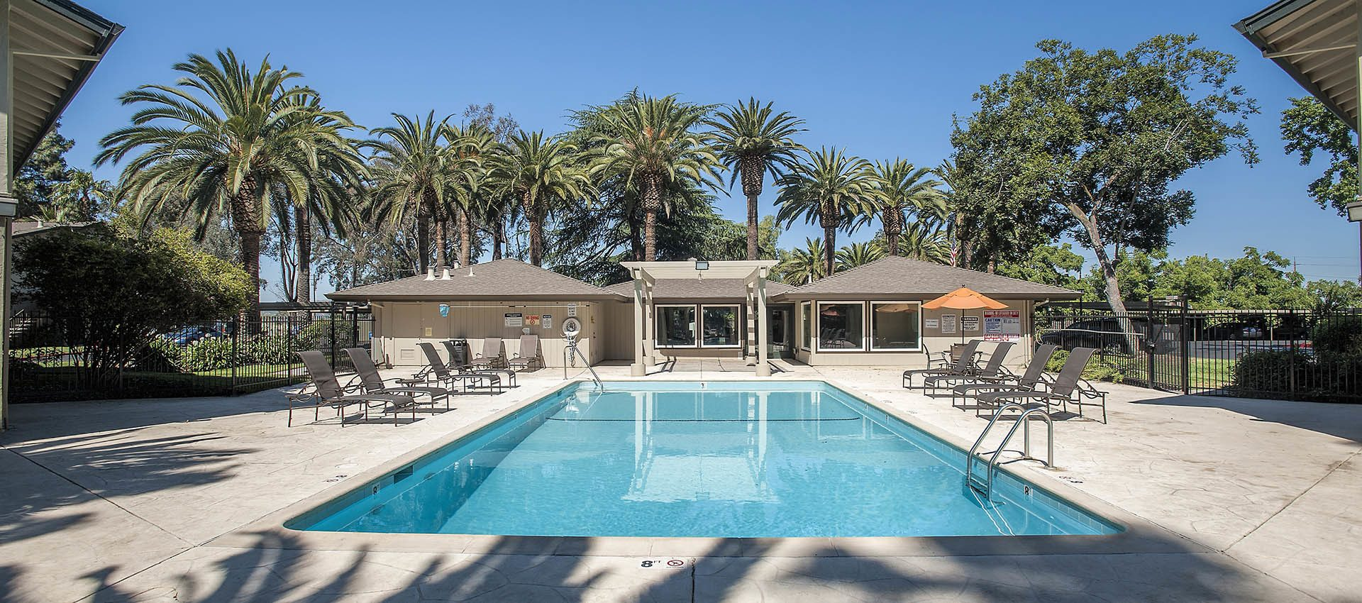 Amenities include a sparkling outdoor pool